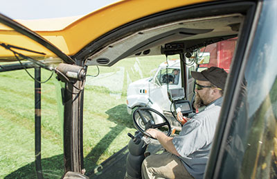 Man-Driving-Tractor-in-Field