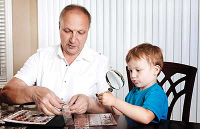 Grandfather Grandson Sharing Coin Collection